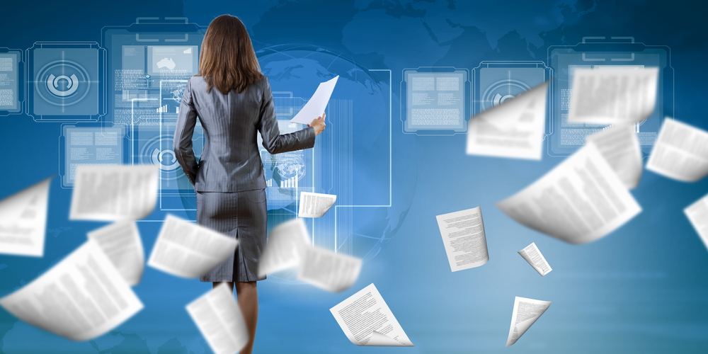 Back view of businesswoman holding papers in hands